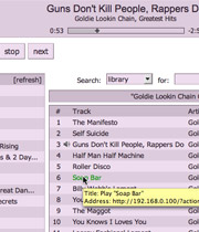 A screenshot of the zTunes interface, showing a tracklisting table and playlists.
